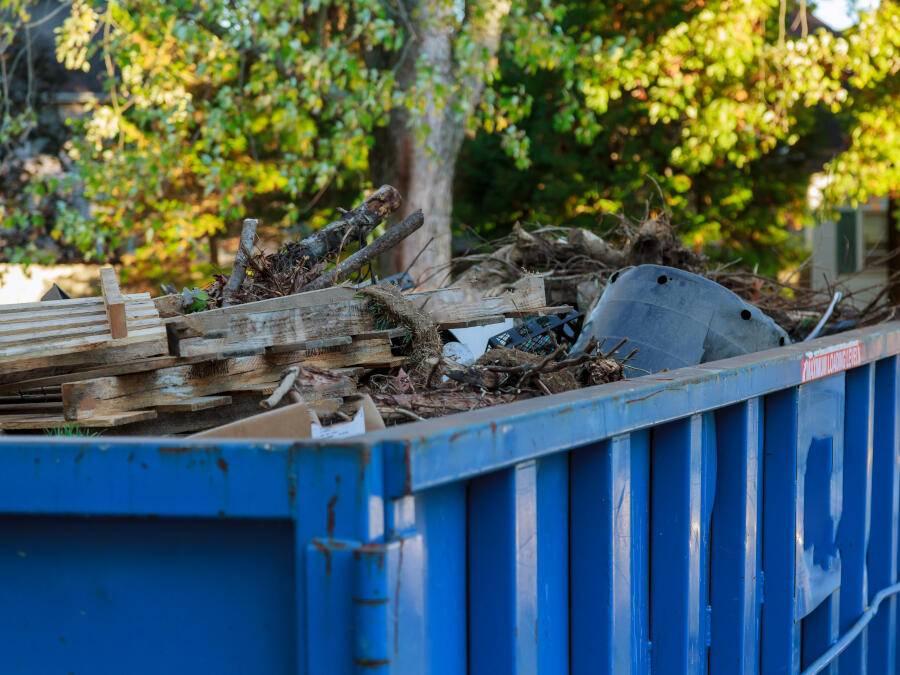 blue skip filled with debris.