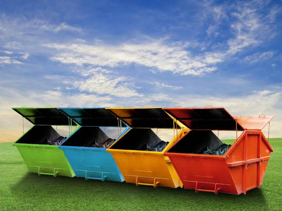 Row of different colour skips