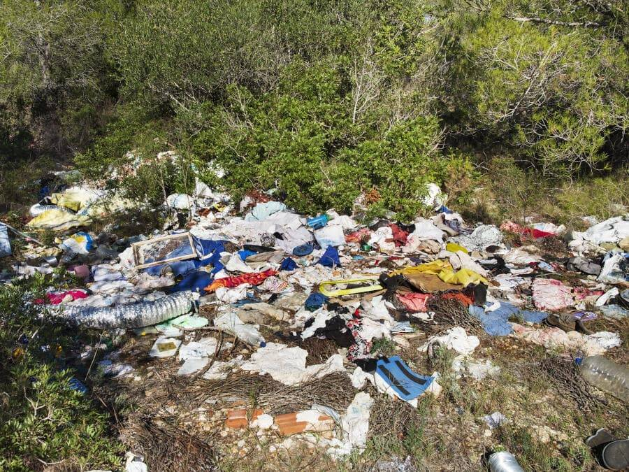 Fly tipping waste in a ditch