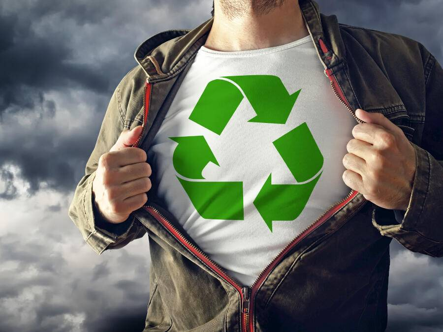 Man stretching jacket to reveal shirt with recycle symbol printed