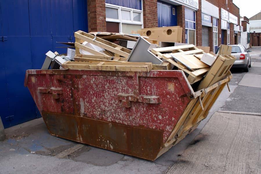 Wooden waste in red skip