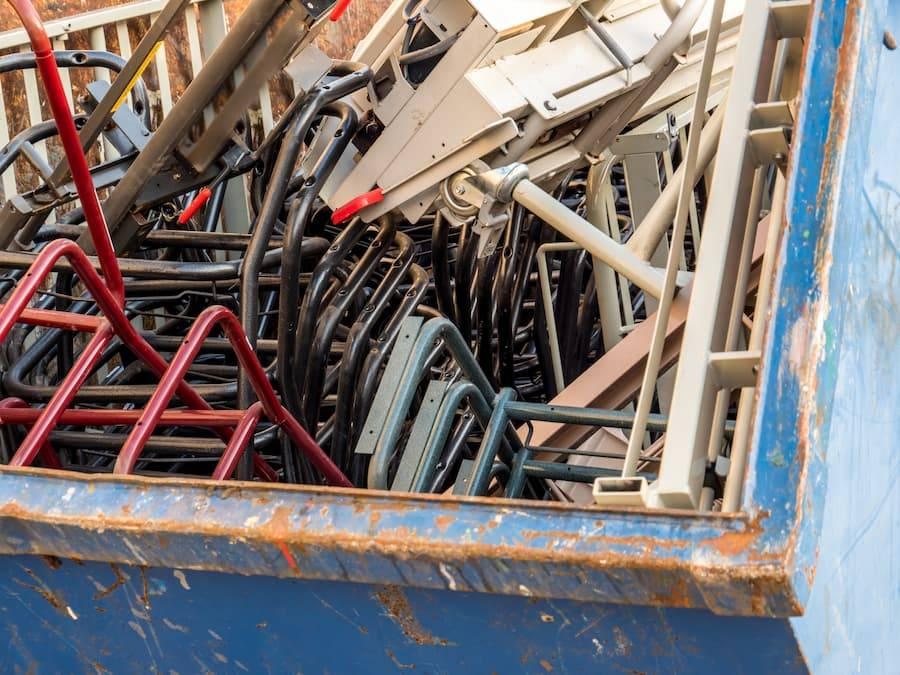 Metal waste in blue skip